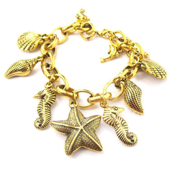 Sea Creatures Themed Charm Bracelet in Gold: Starfish Seahorse Seashell Dolphins | DOTOLY