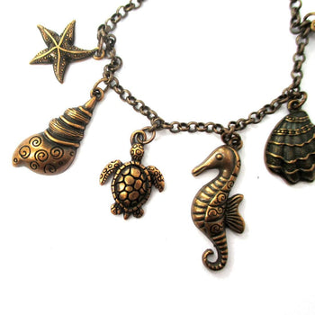 Seashell Turtle Starfish Seahorse Sea Creatures Charm Bracelet in Bronze | DOTOLY