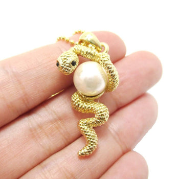 Snake Wrapped Around a Pearl Shaped Animal Pendant Necklace in Gold | DOTOLY