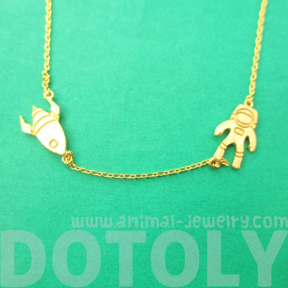 Spaceship and Astronaut Space Travel Themed Charm Necklace in Gold | DOTOLY | DOTOLY