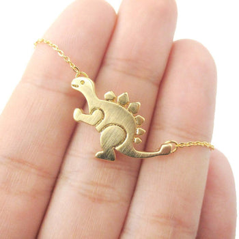 Stegosaurus Dinosaur Shaped Jurassic World Themed Pendant Necklace in Gold | DOTOLY