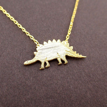 Stegosaurus Dinosaur Silhouette Jurassic World Themed Charm Necklace in Gold | DOTOLY