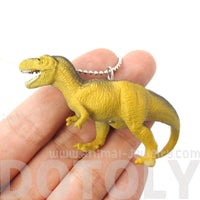 T-Rex Dinosaur Shaped Figurine Pendant Necklace in Yellow and Grey | Animal Jewelry | DOTOLY