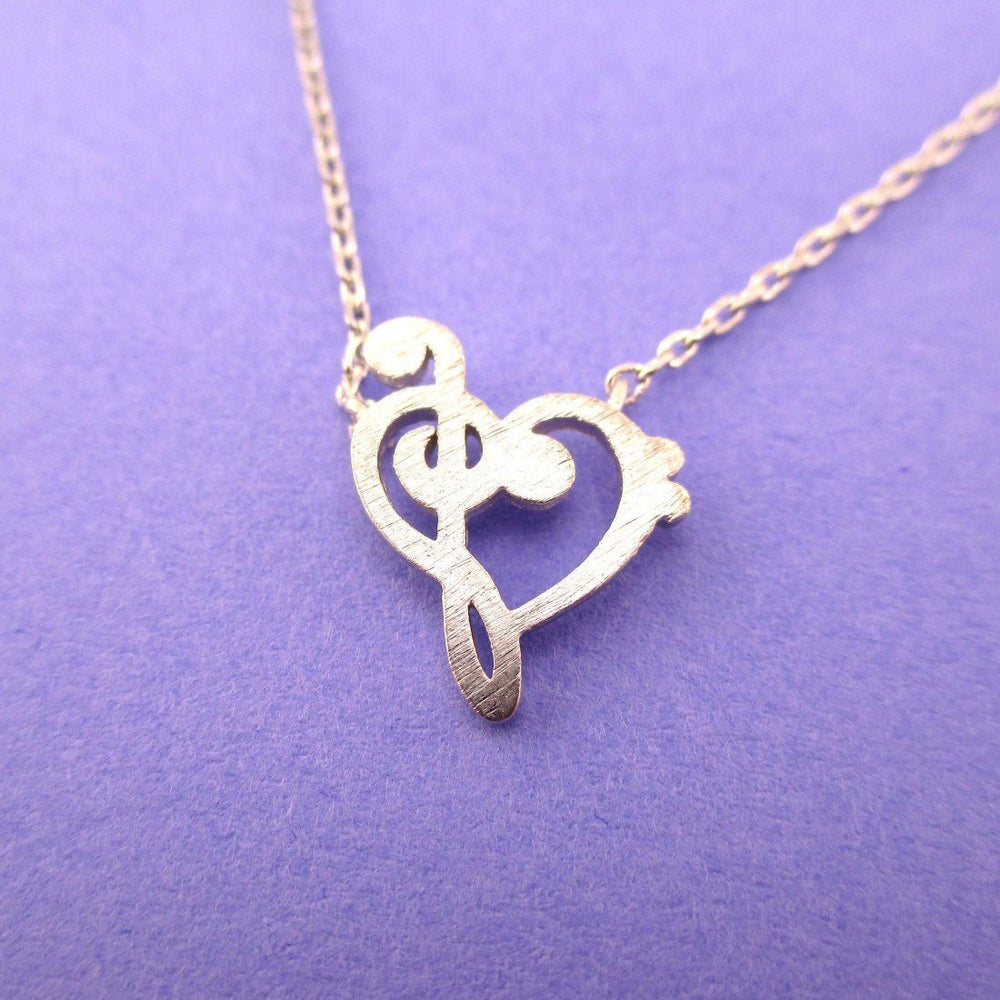 Treble and Bass Clef Heart Shaped Music Lovers Charm Necklace in Silver | DOTOLY