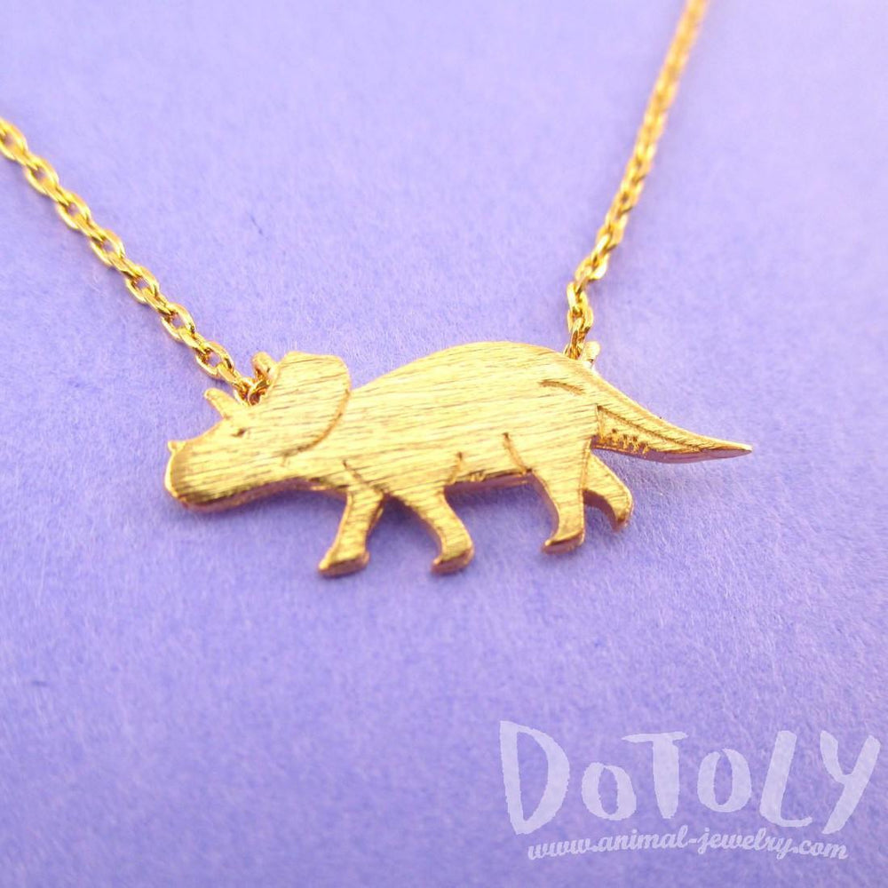 Triceratops Dinosaur Silhouette Jurassic World Themed Charm Necklace in Gold | DOTOLY