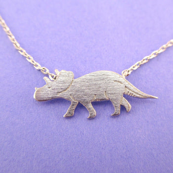 Triceratops Dinosaur Silhouette Jurassic World Themed Charm Necklace in Silver | DOTOLY