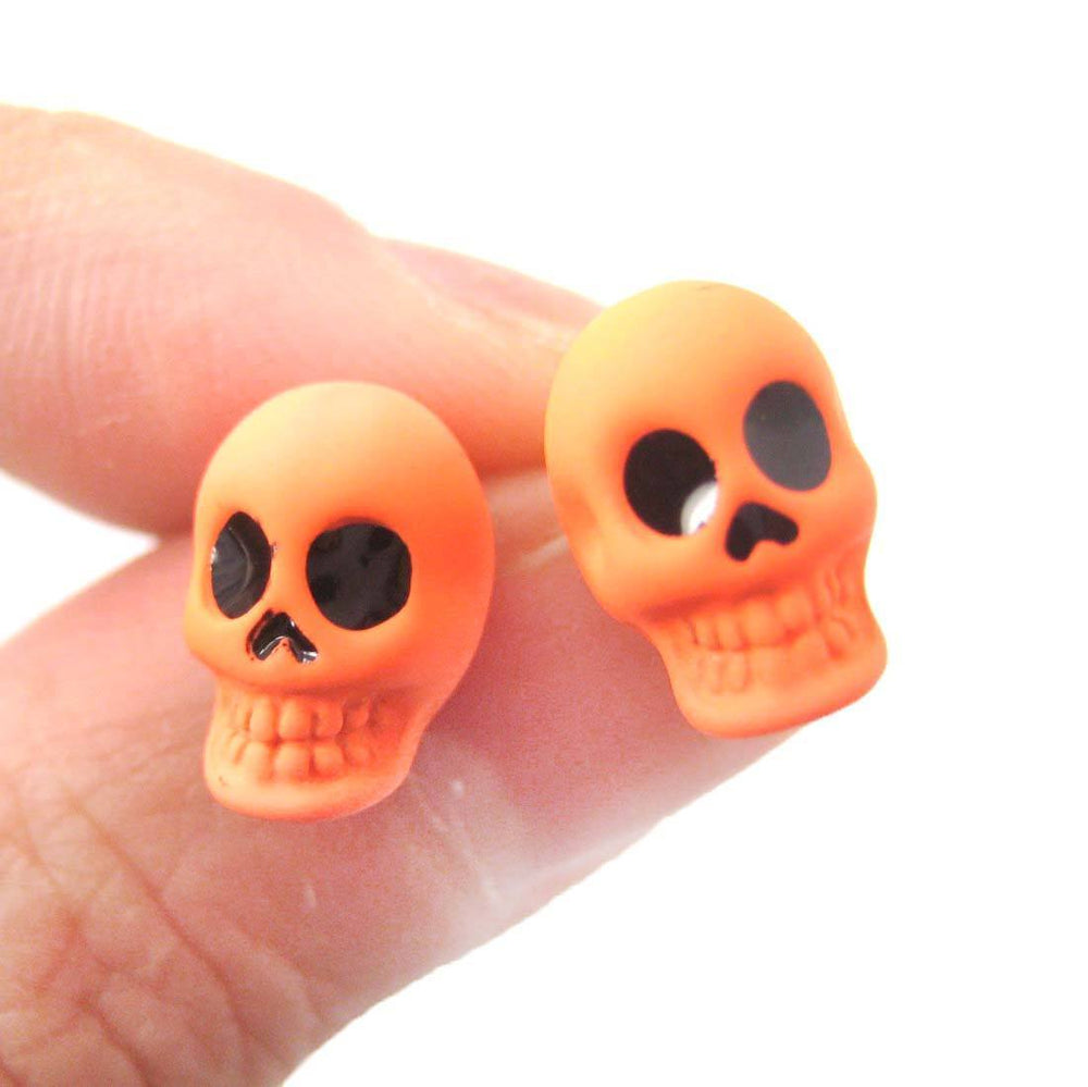 Unisex Skull Shaped Skeleton Themed Rocker Chic Stud Earrings in Neon Orange | DOTOLY