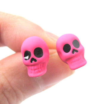 Unisex Skull Shaped Skeleton Themed Rocker Chic Stud Earrings in Neon Pink | DOTOLY