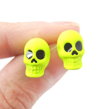 Unisex Skull Shaped Skeleton Themed Rocker Chic Stud Earrings in Neon Yellow | DOTOLY