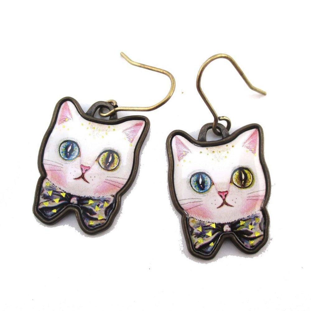 White Odd Eyed Cat With a Bow Shaped Enamel Dangle Earrings | DOTOLY