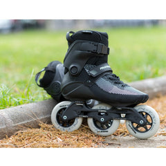 Powerslide Swell Lite Black 1OO Inline Skate, outdoors with a grassy field in the background