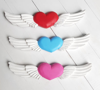 Wooden heart with wings