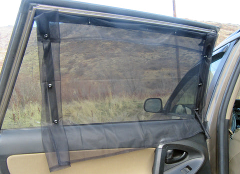Magnetic car window screens folded over