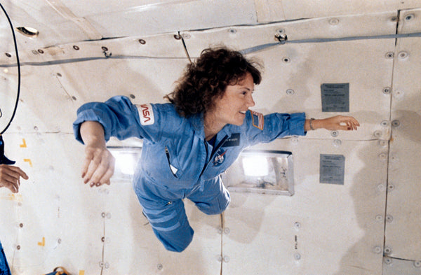 Christa McAuliffe floating in zero G