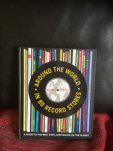 Around the World in 80 Record Stores: A guide to the best vinyl emporiums on the planet Hardcover – Marcus Barnes