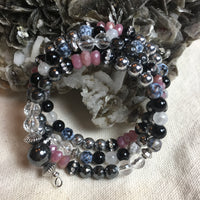 MALA Bracelet with Clear Quartz Faceted, Hematite Faceted, Black Onyx Rhinestone, Rondelle Ruby Faceted, Silver Hematite, Black Agate, White Moonstone, Dragon's Vein Faceted, Hematite GURU Bead, on memory wire