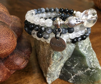 MALA Bracelet with Black Dyed Agate, Black Faceted Labradorite, Snowflake Obsidian, Black Rutilated Quartz, White Moonstone, Crackle Clear Quartz, and Clear Quartz GURU Bead, on memory wire