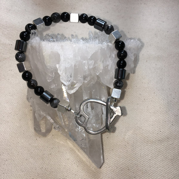 Faceted Black Labradorite, Black Onyx, Black Agate, Hematite Drums, Pewter Cubes, Brass Heart Toggle