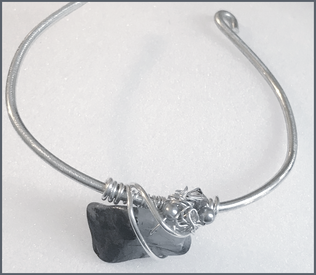 Handmade jewelry by Dee Van Houten. Sterling silver wire-wrapped, raw crystal bracelet.
