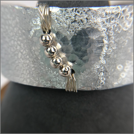 "DevaArt Studio Handmade Jewelry - Cuff Bracelet - ""Mercury"" - hand-textured, free-form design, wire-wrapped in sterling silver, 1"" wide light weight aluminum cuff hand-etched with a free-form design and heart in center, four sterling silver beads wire-wrapped."