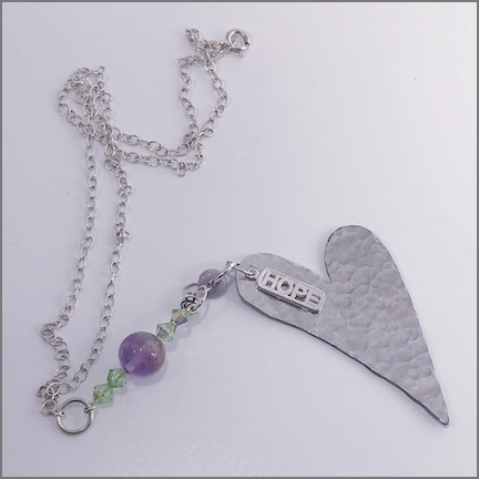 "DevaArt Studio Handmade Fine Art Jewelry - ""Hope"" necklace, hand-textured, hand-hammered large silver heart, Swarovski crystal, sterling silver Hope charm, vintage purple glass bead with 4 green Swarovski crystals, sterling silver oval chain."