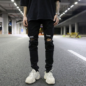 Knee Torn Slim Jeans
