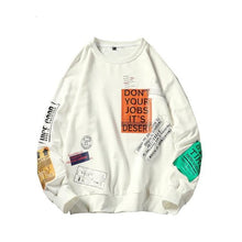 Patched Magazine Sweater