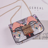 Bow graffiti clutch