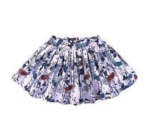 White ruffle skirts with floral print and elastic waist band.