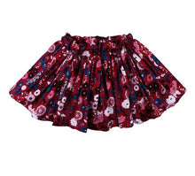 Red ruffle skirts with floral print and elastic waist band.