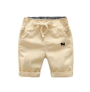 Khaki shorts with embroidered navy blue dog on left front pocket.