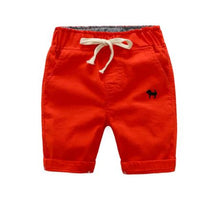 Red-Orange shorts with embroidered navy blue dog on left front pocket.