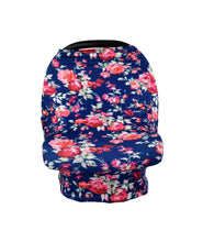 Blue car seat cover with floral print.