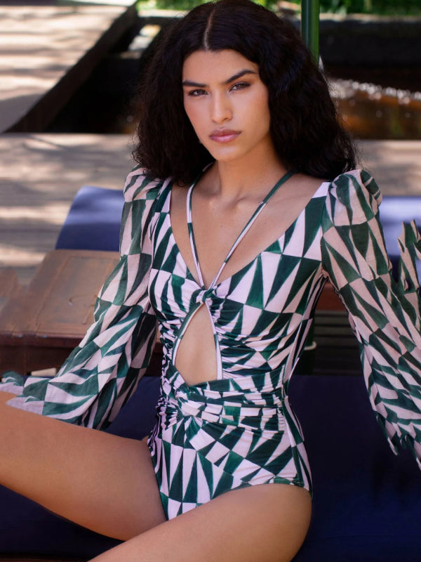 "Luxury collection Geo pink and green triangle geo shaped pattern swimsuit. Made from top durable material, that will last! Hallowed out with long ""airy"" sleeves for top sun protection. High waist and v necktie. If you're going for a high class, prestigious look, this monokini is just for you."
