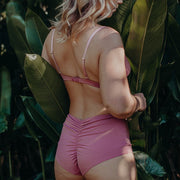 back view of high waisted underwear in dusty rose pink