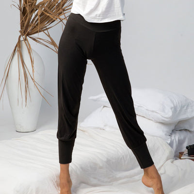 model wearing black lounge pants in organic cotton, organic cotton loungewear, cotton sleepwear
