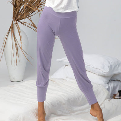 model wearing organic cotton lounge pants in purple, organic cotton lounge wear, organic cotton clothing