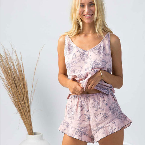 model wearing organic cotton sleepwear singlet tank cami in blush pink