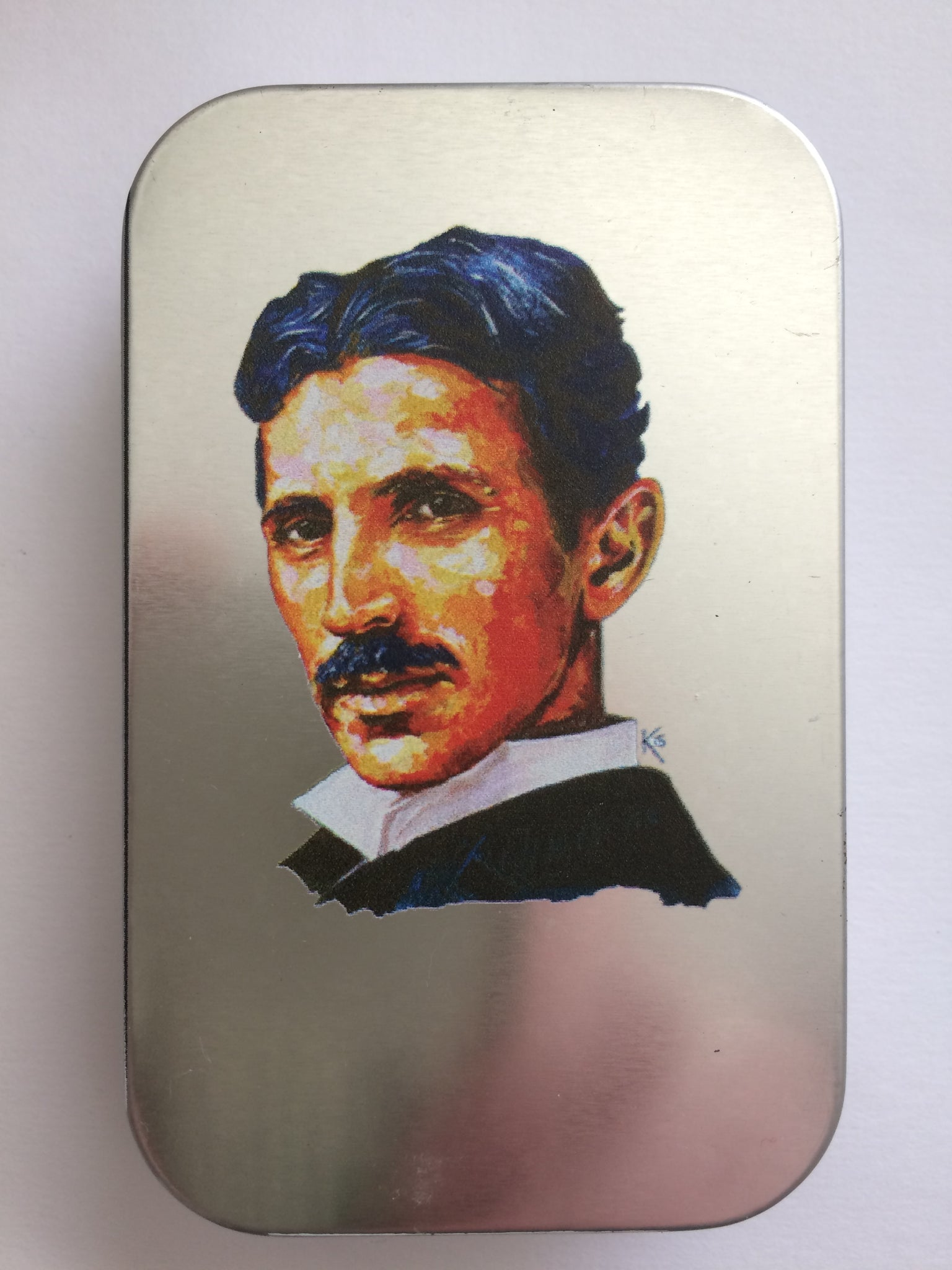 "Tin with ""The Great Inventor - Tesla"" Painting"