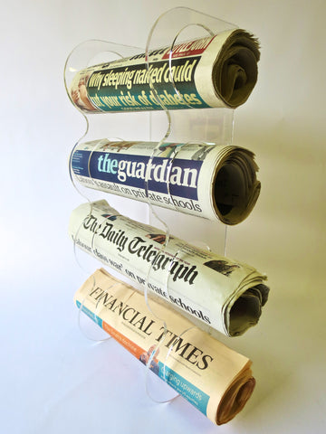 Newspaper wall mounted holder