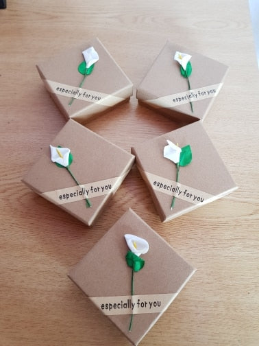 "photo of 5 mini gift boxes with the message ""especially for you"" and a cute little flower attached"