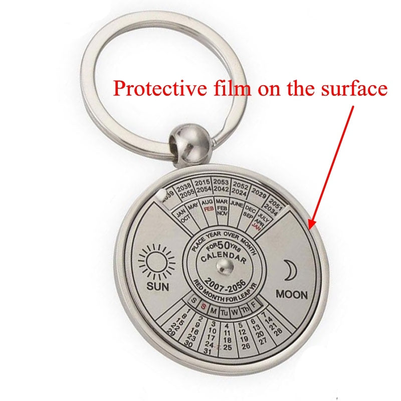 protective film on face of 50 year calendar keychain to protect surface from scratches