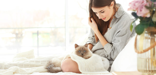 Woman who loves her cat and buys only the best safe healthy and organic products for her cat.
