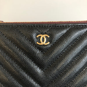 Chanel Mini O Pouch Black Chevron Caviar with gold hardware