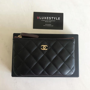 Chanel Mini O Pouch Black Quilted Lambskin with light gold hardware