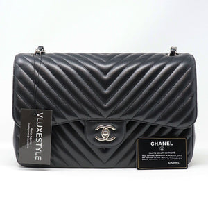 RESERVED: Chanel Classic Jumbo Double Flap 16S Black Chevron Caviar with silver hardware