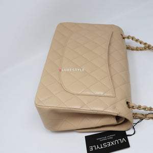 Chanel Classic Jumbo Double Flap Beige Quilted Caviar with gold hardware