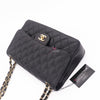 Chanel Classic Jumbo Double Flap Black Quilted Caviar with gold hardware
