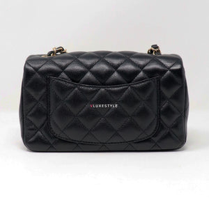 Chanel Classic Mini Rectangular 17B Black Quilted Caviar with light gold hardware.