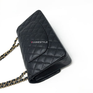 Chanel Classic Black Quilted Caviar Medium Double Flap with gold hardware